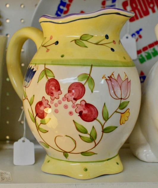 Spring floral pitcher with yellow handle